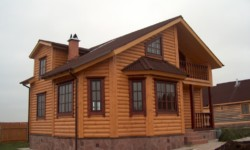 Бревенчатый дом монтаж сайдинга